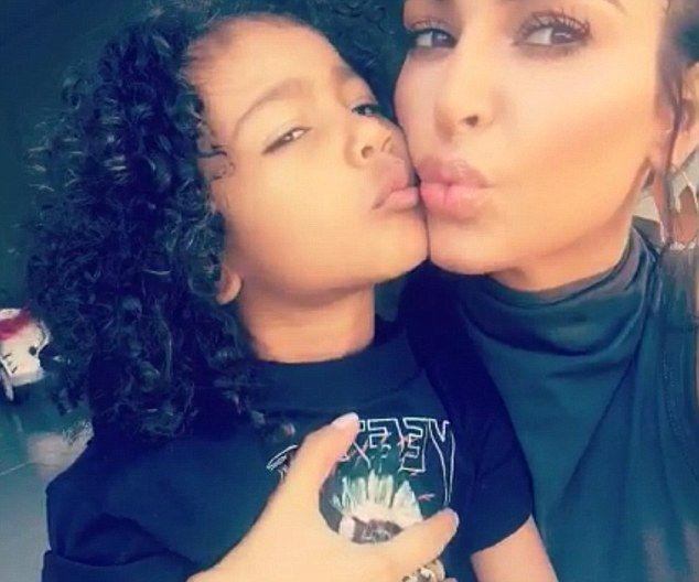 'Gimme kiss!' North West shares a tender moment with mom Kim Kardashian as the pair play with her Minnie Mouse doll in a new Snapchat video