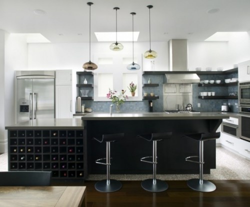 You can determine how high or low to hang your pendant lights and how far apart to place them. Try finding the right rhythm with a series of pendants, like these handblown modern glass beauties from Niche Modern.