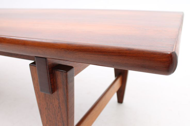 Coffee table in rosewood. Beautiful construction by Illum Wikkelsø. Manufactured by A. Mikael Laursen, Denmark. www.reModern.dk