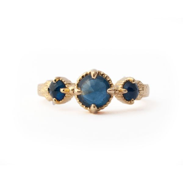 Exquisite hand-engraving graces this luxurious 14KT yellow gold ring highlighted by the deep blue of these beautiful sapphires 0 60CTW Regal classic simply stunning