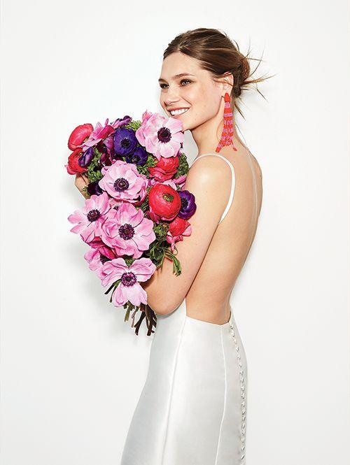A classic @olia_zavozina wedding dress with a modern twist   Brides.com
