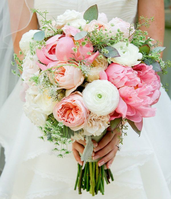 Pretty bridal bouquet with pink and blush peonies and white ranunculus.