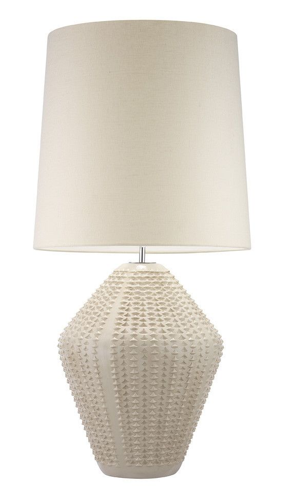 Hericus Antique Ivory Table Lamp African inspired cast textured ceramic base with a distressed antique finish. Also available with an Ivory glaze