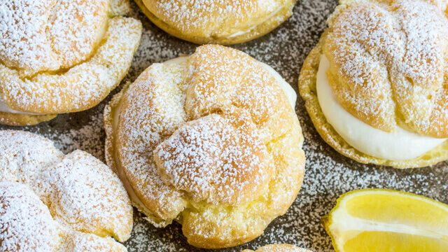 Light and delicious these Lemon Cream Puffs are baked until puffy and filled with a light lemon cream filling! A perfect addition to your dessert line!