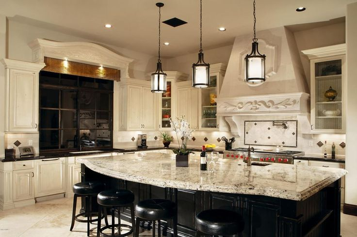 Traditional Kitchen With Breakfast Bar Snowfall Granite Countertop Pendant Light Limestone