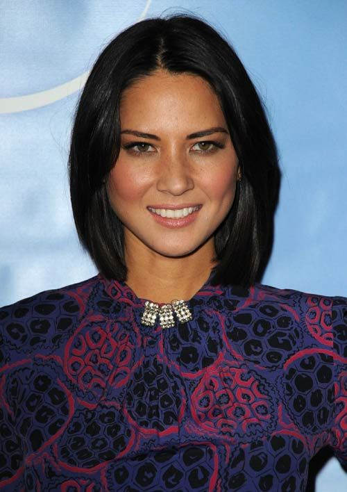 Olivia Munn . Her mother is Chinese and her father is German/Irish.
