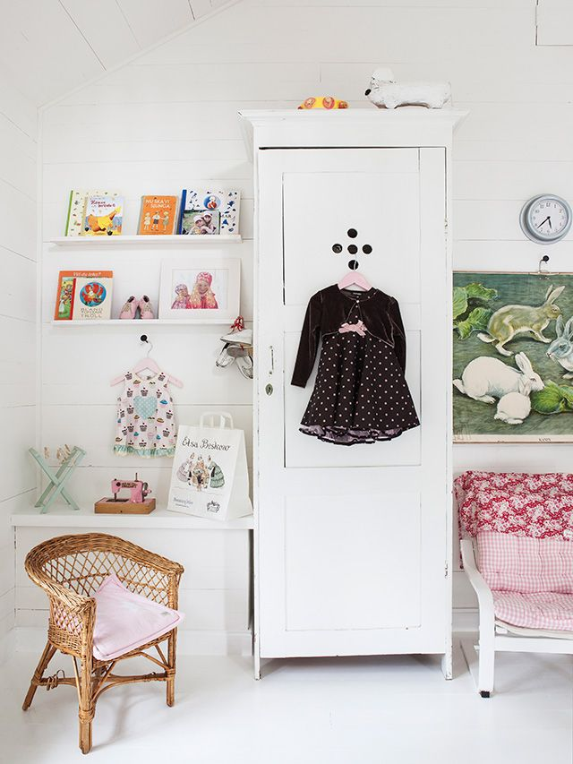 White floor, white walls and white furniture as a base, with colourful accessories to give pops of colour.