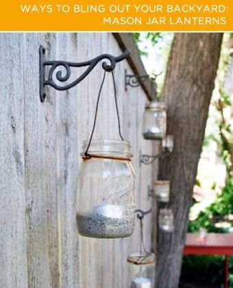 mason jar lanterns hung on fence Four Ways to Bling Out Your Backyard