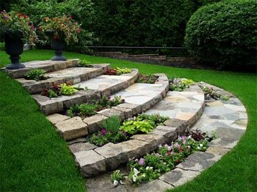 Arched flagstone stairs with built in planters. Perfect for a sloped yard
