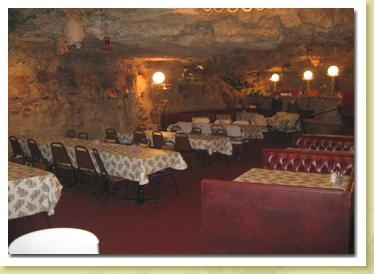 Richland, Missouri   The Cave is the nation's only restaurant located in (you guessed it) a cave, serving American steakhouse/seafood and Italian fare.It has waterfalls, fish ponds, and even a view of the Gasconade River. The space began as a natural cave that served as a dance hall in the 1920s, situated three stories up on a limestone bluff at a campground. Back then it was not spacious enough for 225 to dine, as it is today; the rest was carved and blasted out over the course of four…