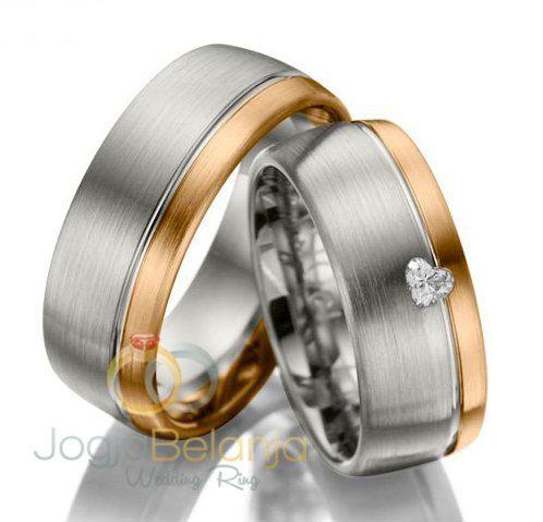 Cincin Kawin Asimahb memiliki konsep kombinasi lapis yang berbeda yaitu warna silver dan emas kuning. Terbuat dari emas murni yang dibuat oleh Pengerajin Profesinal Kotagede dengan bahan pilihan yang bermutu danberkualitas. Dengan desain yang elegan yang difinising doff amplas, dan tambahan 1 buah batu zircone putih berkualitas berbentuk hati pada yang dipasang pada permukaan cincin...