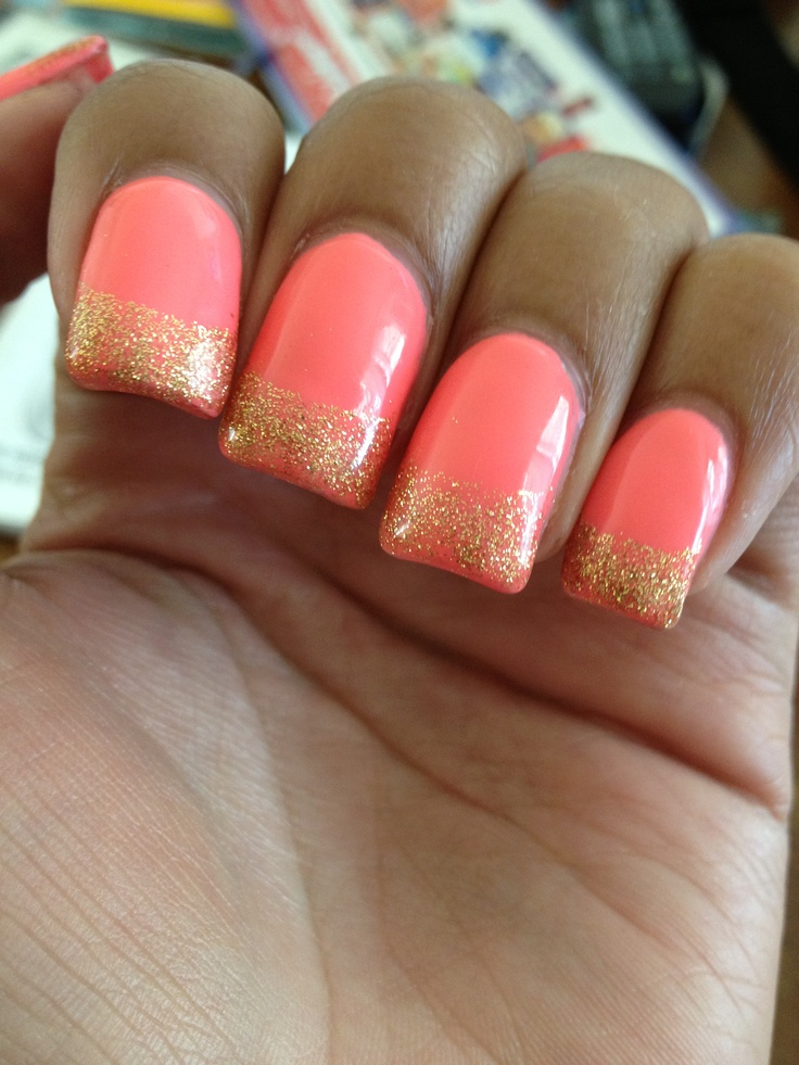 Gel nails. Summer colors. Salmon orange with gold glitter tips.