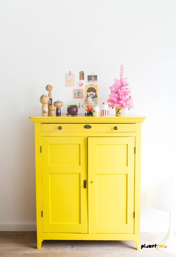 Paint a small piece of furniture bright yellow for an unexpected pop of color