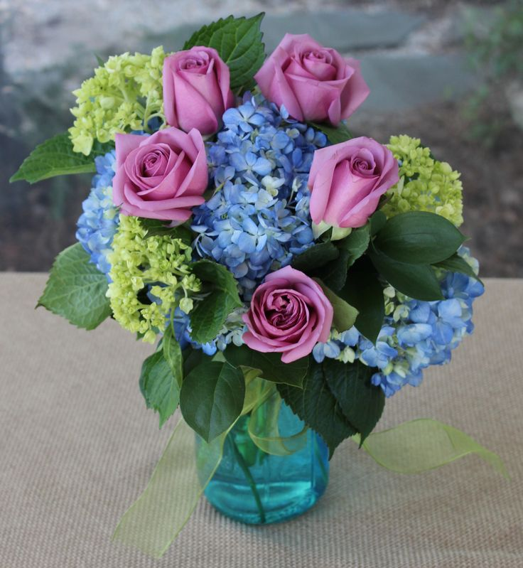 Floral Arrangement In Blue Mason Jar Container With