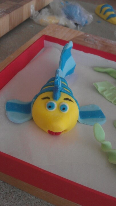 Handmade fondant flounder from the little mermaid!  Only took nearly 3hr to get it perfect lol!