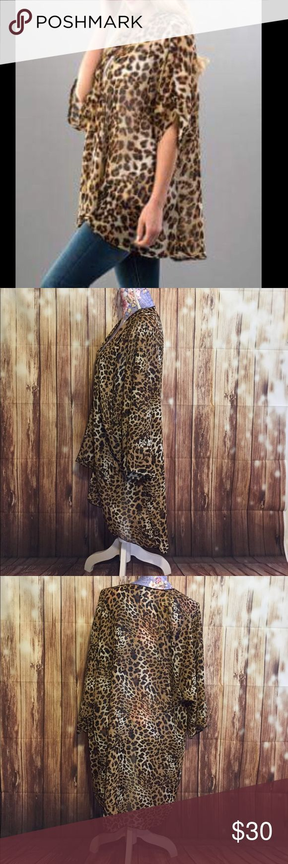 Sheer leopard print Cardigan NWT Leopard print Cardigan that is sheer. It is longer in the back and would look great with leggings! Made in the USA. 100% Polyester. BOUTIQUE Tops