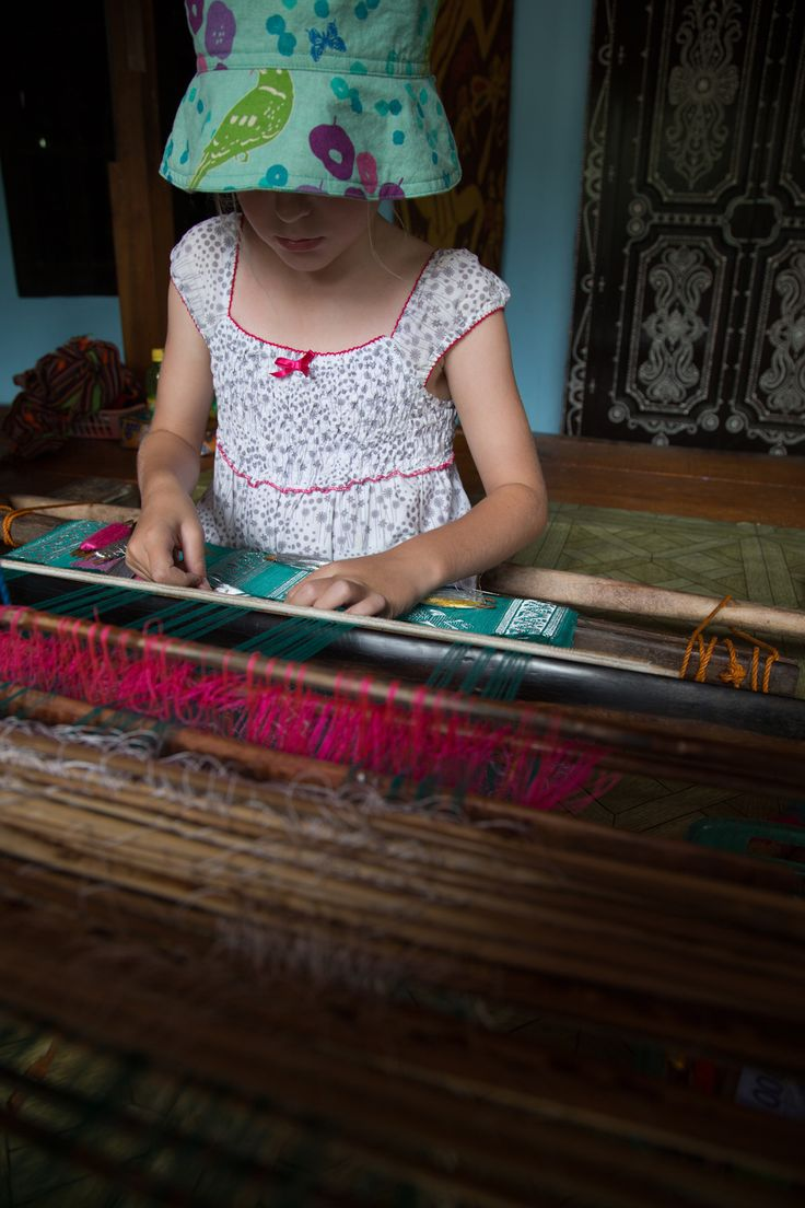 The textiles in Lombok are gorgeous - Meg has a go at weaving! See more of our family adventure in Indonesia over at: smalltravelbugs.com