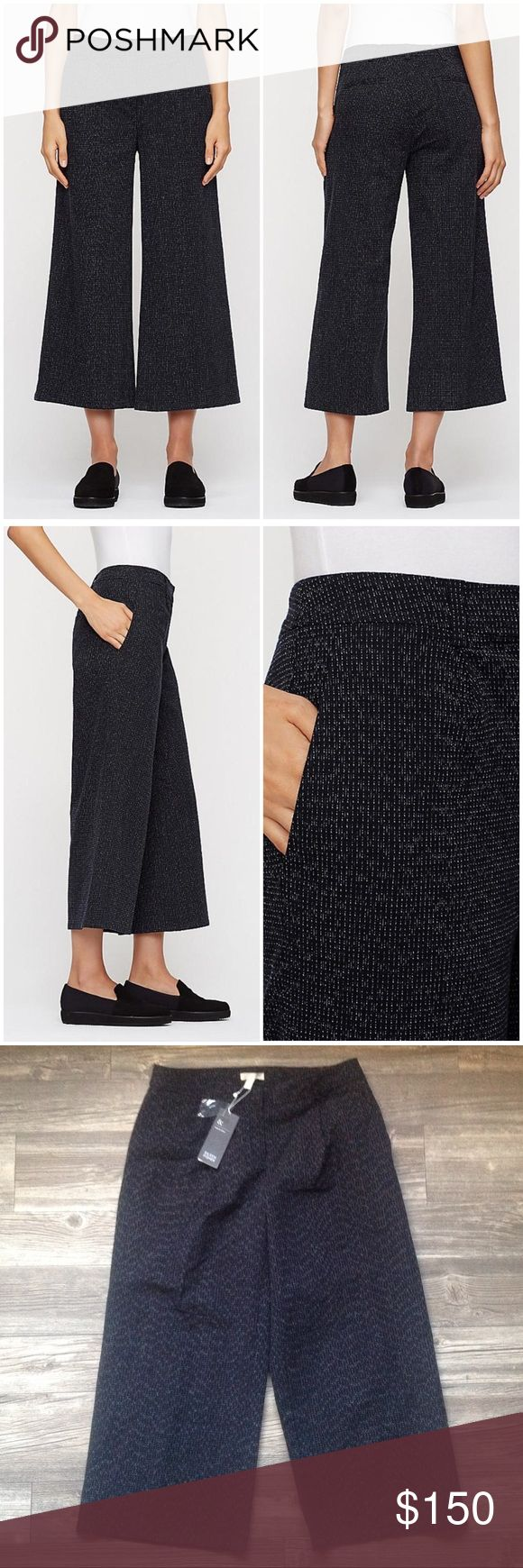 """Eileen Fisher Wide Cropped Pant """"Softly structured, in an artful weave inspired by traditional craft techniques. Smooth through the hips, flared through the leg. Trouser styling with belt loops, angled front pockets and back welt pockets. 1 1/2-inch waistband, front pleats, back darts. Fly front with corozo button and hook and bar closure. 10-inch rise, 24-inch inseam. An organic cotton weave with an intricate rainfall pattern inspired by kasuri, a traditional Japanese dyeing technique.""""…"""
