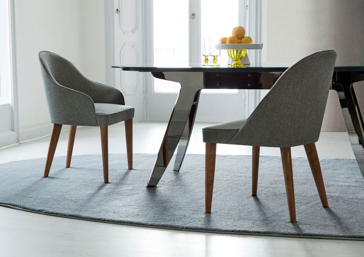 DINING ROOM | Judy fabric chair and Ring table black chromed steel base.