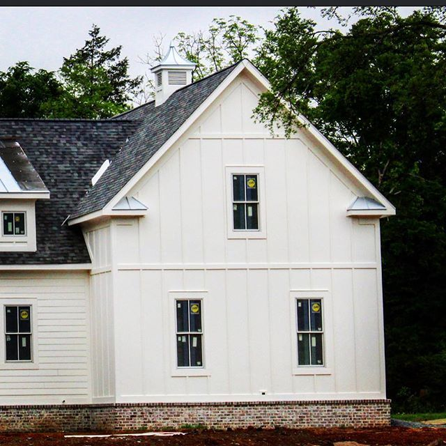 Farmhouse With Board And Batten Custom Cupola And Pella Windows Paint Color Is Simply White Exterior House Siding Exterior House Colors Window Trim Exterior
