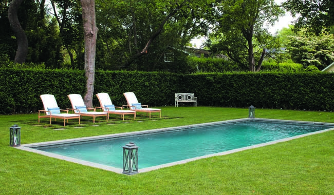 Ralph Lauren towels are at the ready for impulsive dips in the gunite pool. The chaises are by Janus et Cie.
