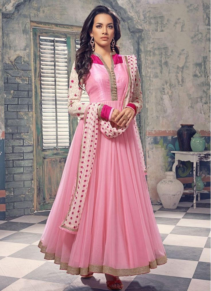 Impersonate into mixture of boldness and beauty in this pink shade faux georgette anarkali salwar kameez. Beautifully crafted with embroidered and lace gives it an authentic ethnic appeal....
