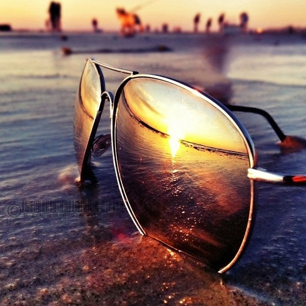 reflection of the beach thru sunglasses. Love this.