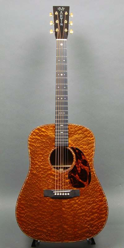 ENLARGE PHOTO to really see the three dimensional look of the guitar top on this gorgeous acoustic Martin D-41 Custom guitar.  A 2012 NAMM Show model, where the best of the best instruments are showcased. Quilted Sapele top, back & side. #cSw:) - 4 5 6 STRINGS, this has qualified as a MOST POPULAR RE-PIN, https://www.pinterest.com/DianaDeeOsborne/ddo-most-popular-re-pins/