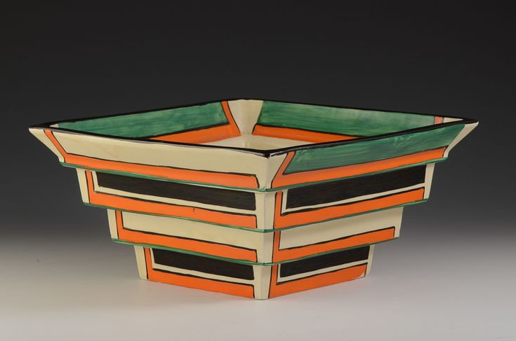 Clarice CLIFF RARE ORANGE L 367 SHAPE STEPPED BOWL C.1929. One of the very best art deco shapes she produced this example is the perfect combination of shape and pattern. The design looks like it was made for stepped shapes and looks stunning. The 4 tiered bowl is the rarest of shapes from this range and this one is decorated on every step and angle, also to the interior.  (hva)