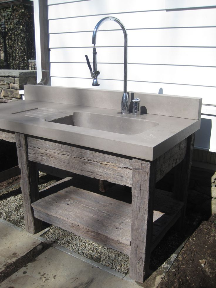 Reclaimed wood vanity base and concrete bathroom sink by for Recycled bathroom sinks
