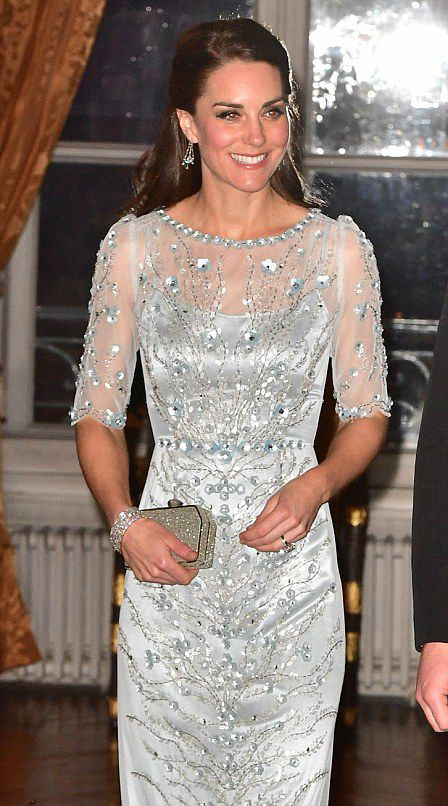 Catherine, Duchess of Cambridge dazzled in ice blue satin gown had a sheer overlay with exquisite crystal beading and floral embroidery throughout and modest short sleeves. The dress also had oversize sequin trimming at the neck, sleeves and waist removing any need for a necklace or belt. Accessories were kept in the same color family- all in silver and steel tones.