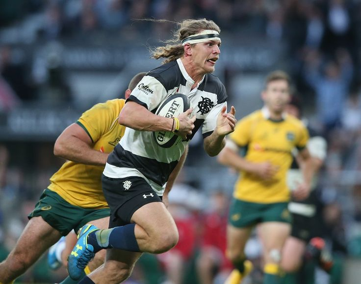 Nick Cummins busts forward for Barbarians
