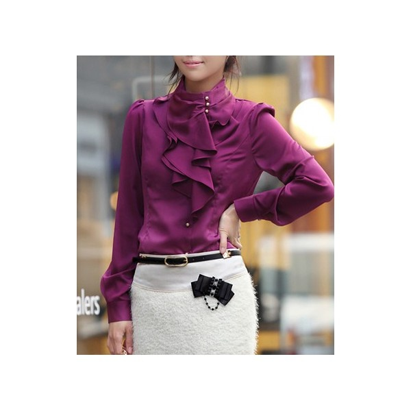 Long sleeve button blouse with standing mandarin collar and ruffled center.
