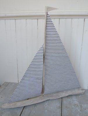 blue ticking driftwood sailboat