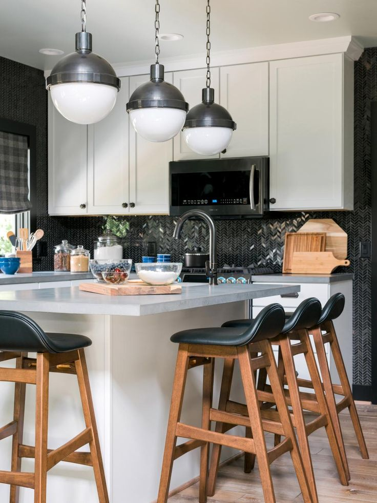 In the kitchen, a shimmery geometric backsplash lends a little glam to white cabinetry and concrete countertops, while innovative (and great-looking) appliances make the space top-of-class smart.