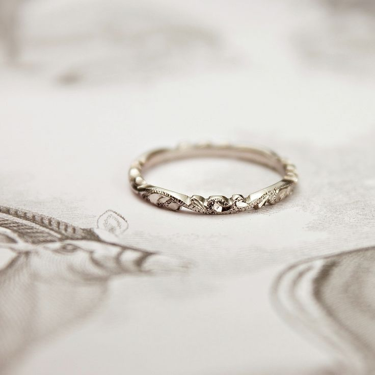 Gorgeous palladium 2mm floral carved wedding band. Also comes in a version that has a V shape.