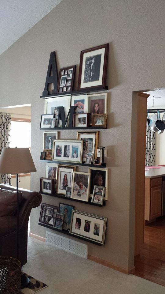 My children's photo wall. The picture ledge link from Ikea is below. They were the best price I could find. Shipping was a little expensive at $25 but so well worth it.