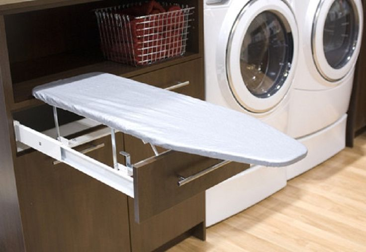 Built in ironing board laundry room with high end washer and dryer with pedestal a dream home - High end laundry hamper ...