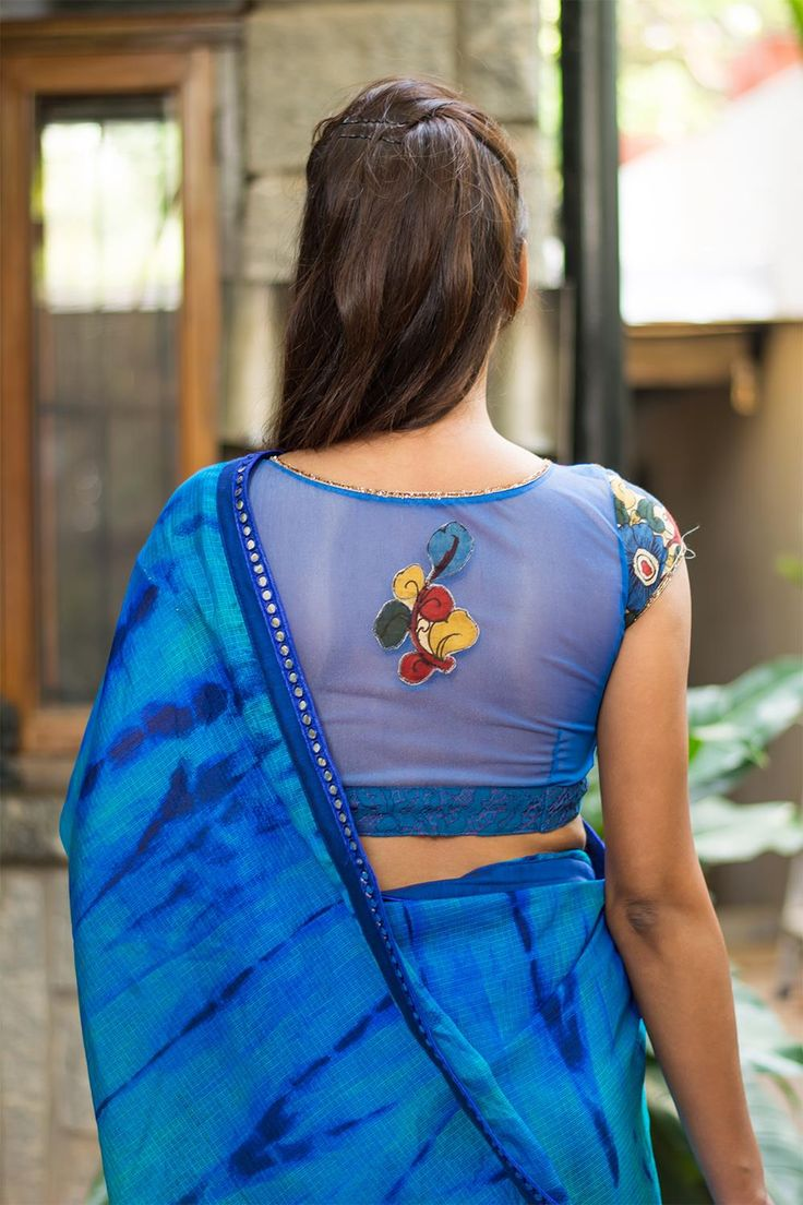 Detail magic at work again! With a cool kalamkari yoke on a blue cotton lace body and a striking sheer net back having a kalamkari appliqué, this number is full of surprises.Pair with any blue saree. Or pick a color in the kalamkari work and own your style! #kalamkari #saree #india #blouse #houseofblouse