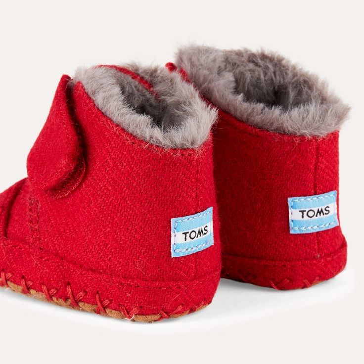 5c706476941 The TOMS Cuna Layette Boots - We love the faux fur lining of these little  TOMS baby boots. Perfect for staying warm on the go.