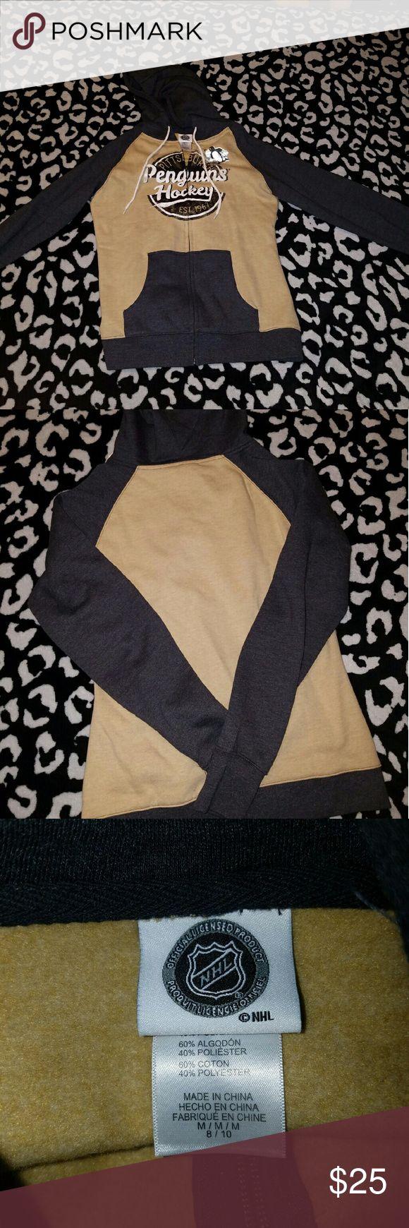 Never worn! Pittsburgh Penguins zip up hoodie! NWOT NHL licensed brand women's Pittsburgh Penguins full zip hoodie. Good quality, thick. Tan/gold and gray. NHL Tops Sweatshirts & Hoodies