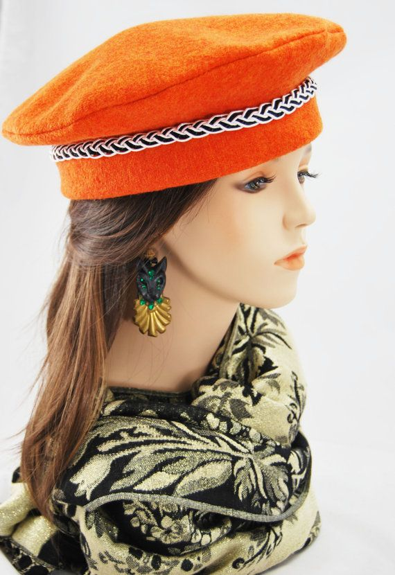 Brighten up your winter with this brilliant Orange Wool Beret with its smart Black and White Braid. Lined with Black Satin.  Approx head