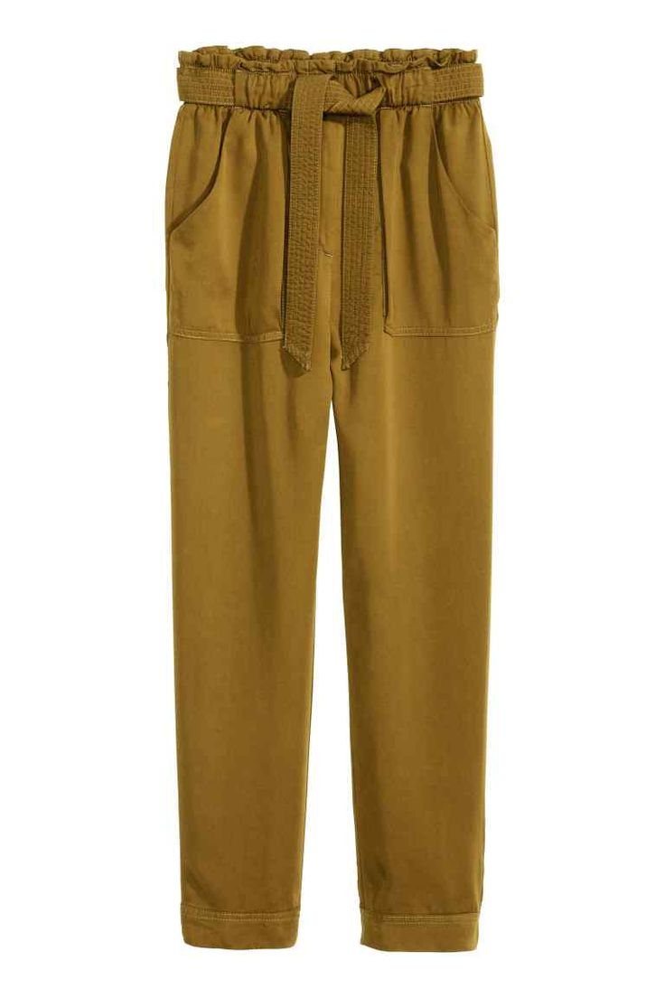 Trousers Loose fit: CONSCIOUS. Joggers in woven fabric with a slight sheen made from Tencel® lyocell, with an elasticated drawstring waist, patch pockets at the front and sewn-in turn-ups at the hems.