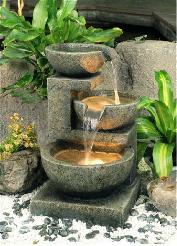 une fontaine de jardin design quelques id es en photos. Black Bedroom Furniture Sets. Home Design Ideas