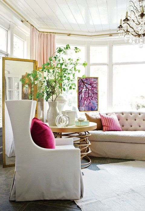 Pink accents + natural light. Living room.