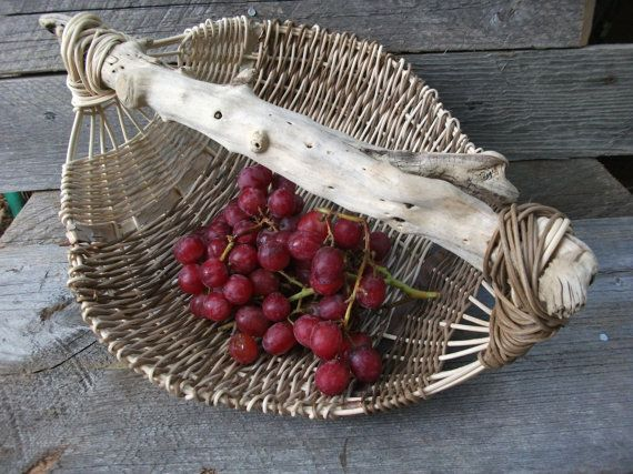 Oval wicker basket with driftwood handle by StormWeave on Etsy