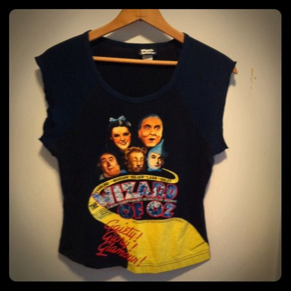 Wizard Of Oz Baby-Doll Tee Short sleeved tee. Bought in the early 2000's so it's in the baseball shirt style. Fits more like medium/ tight fitted large. Sleeves are beginning to unravel (see pic) but it's really not noticeable. Great for a Wizard of Oz fan! Ripple Junction Tops