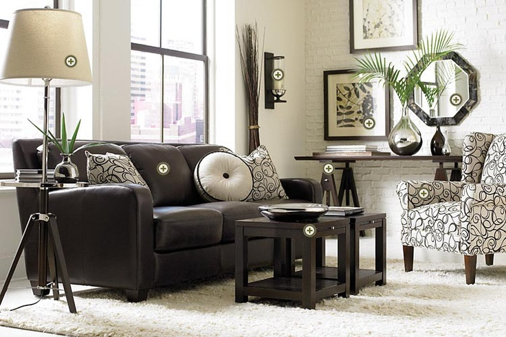Could definitely get on board with the patterned chair and solid couch