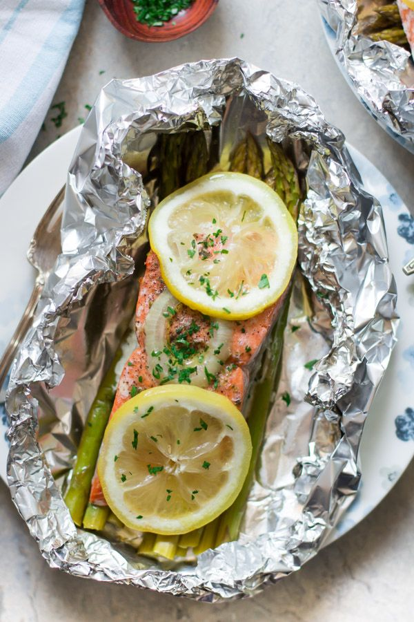 Foil Baked Salmon Recipe - This is the easiest way to make salmon in foil. It is baked over a bed of asparagus. Gluten-free, paleo, and low-carb!