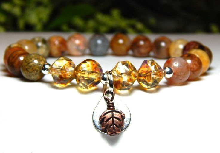 This beautiful agate bracelet is made with 8mm Rainbow Agate and gorgeous central cut czech beads with a pretty handmade leaf charm. Agate Properties: Known to be powerful healers. Believed to help wi